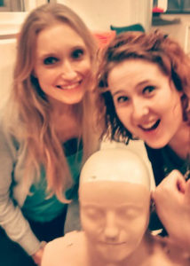 Two med students with head